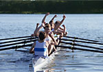 Rowers in boat cheering